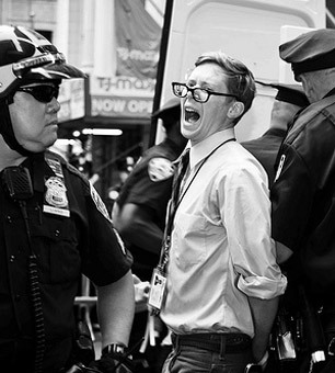 Journalist John Knefel being arrested for the second time by NYPD. Dressed in a shirt and tie with his press badge around his neck. (via My State-Sponsored Assault, Courtesy of the NYPD) (Photo: Glenn Halog)