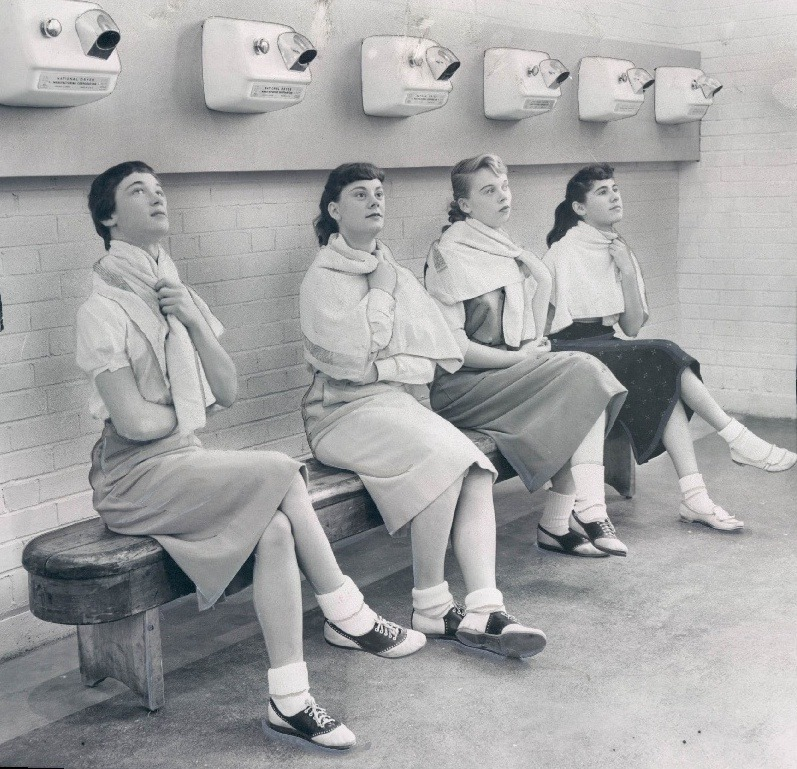calumet412:  Girls demonstrating hand dryers that had been installed to dry their hair after gym at Highland Park High School, 1956.  FANCY