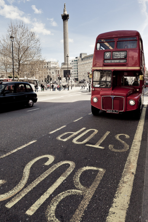 Old bus in Trafalgar Square. London.