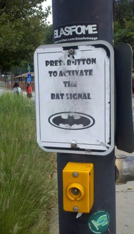 Press Button to Activate the Bat Signal The Dark Knight Crosses (the street).