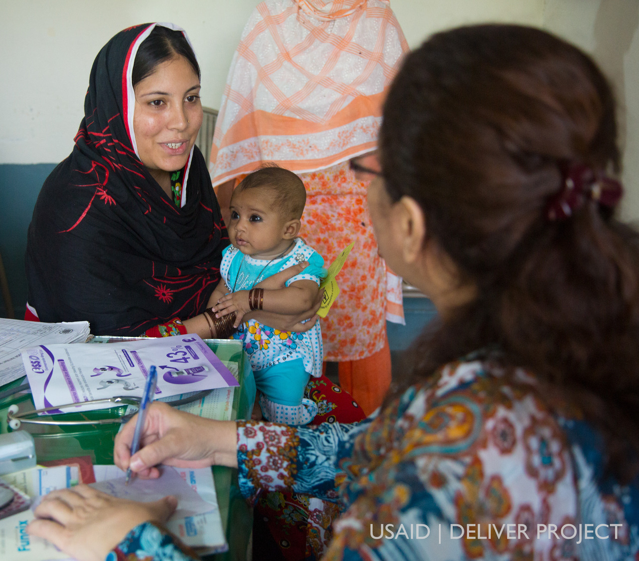 "Photo Credit: Derek Brown, USAID | DELIVER PROJECT At a Basic Health Unit in Punjab Province, Pakistan, 23-year-old Tahira Rashid receives counseling by Dr. Fauzia Amin, a female medical Officer.   ""I have one child less than one year of age and my mother in law has passed away and it is difficult for me to handle the child and house work together. So, I came here for a gap before the next baby. Dr. Fauzia Amin is guiding me and helping me to avoid pregnancy.""  -Tahira Rashid"