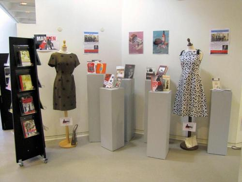 ultrapearl:  Today I set up mannequins with costumes from the 50s and 60s all over our library. I did this because we have a Mad Men event on Thursday where a movie- and book critic and journalist comes to give a talk on why the series is so popular. She also wrote a book on the subject. Anyway, I have been planning this event for months, ordering the costumes, the mannequins and making posters and flyers and finding lit from the era and this week is going to be great! I have the dream job.  I wish our library did displays this lovely. (Although our Banned Books Week display is shaping up pretty nicely.)