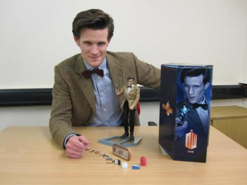 Matt Smith with his Eleventh Doctor action figure