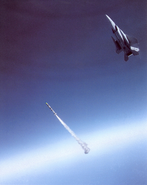 "ikenbot:  Shoot to Kill Air Force Space Command celebrated its 30th anniversary on September 1, 2012. This photo illustration depicts a milestone in the history of the command. On September 13, 1985, the first Air-Launched Anti-Satellite Missile (ASAT) successfully destroyed its target. Maj. Wilbert ""Doug"" Pearson flew a highly modified F-15A over Edwards Air Force Base, CA, and scored a direct hit on a satellite in orbit 340 miles above the Earth."