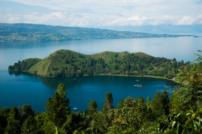 ninieq:  Toba Lake, North Sumatera, Indonesia The lake is 100 kilometres long and 30 kilometres wide. Lake Toba is the site of a supervolcanic eruption that occurred thousands years ago. It is the largest known explosive eruption anywhere on earth in the last 25 million years.