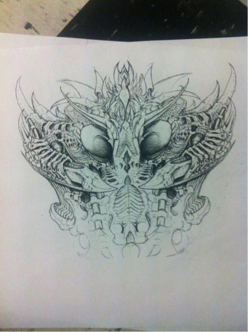 A biomech gas mask I'm drawing and going to be tattooing on a friend. So close to done.