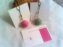 Check out our Minikin Macaron Phone Charms∠☆ Hang them on your zipper and key chain, too! $4 ea. + ship.Available in various colors and matching straps. (ノ◕ヮ◕)ノ*:・゚✧