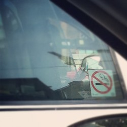 Cop in his car on his iPhone  (Taken with Instagram)
