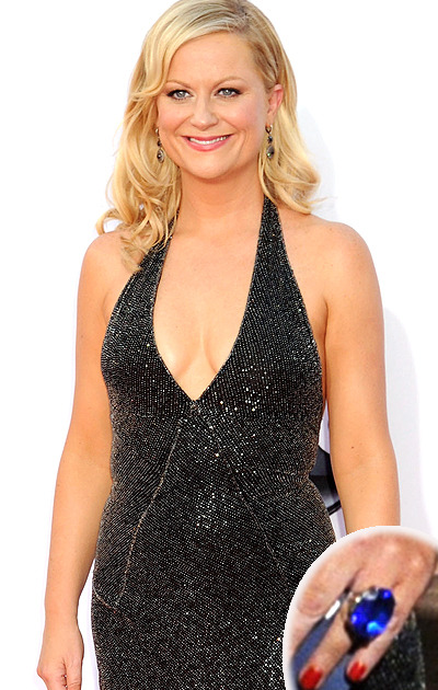 suicideblonde:  Amy Poehler wearing a toy ring from her son in place of her wedding ring on the Emmy red carpet last night.