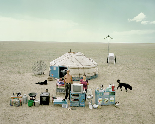 A family outside their yurt in inner Mongolia, from Chinese families' worldly goods in Huang Qingjun's pictures