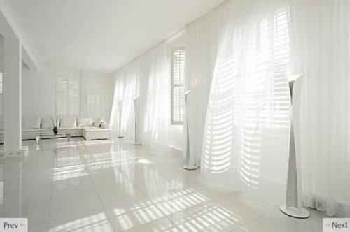 White Flowing Curtains In White Interior