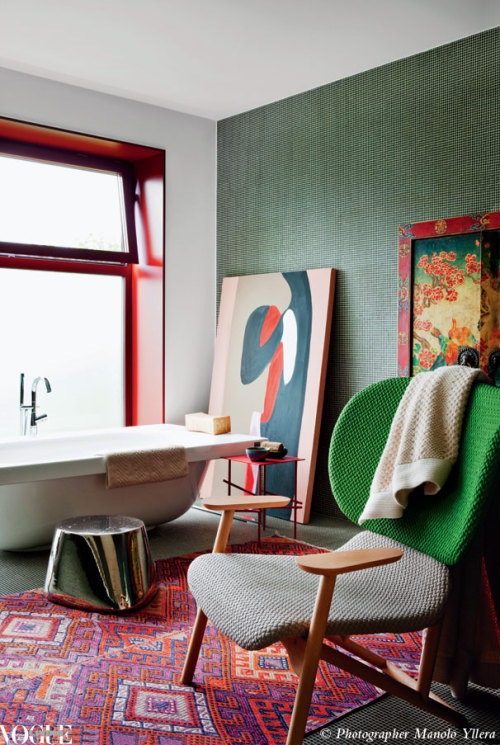 Spanish designer Patricia Urquiola designed this striking bathroom for her friend Patrizia Moroso of the Moroso furniture family. It features select Moroso pieces alongside Urquiola's own designs and an eclectic collection of artworks and soft furnishing. From 'Lady in Red', a story on page 204 of Vogue Living Sept/Oct 2012. Photograph by Manolo Yllera.