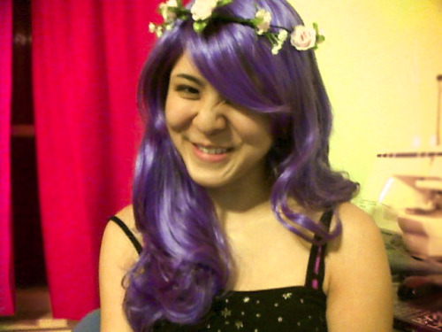 My roommate Caro and I decided that I have to wear this wig to class one day. But only if I wear the floral headband too - along with black clothing to ofset the ultra-sweet nature of fairy hair and flowers. This wig was a $16 impulse buy from last year.. I'm trying to get myself to wear it out so that I can justify getting a black wig from Arda~