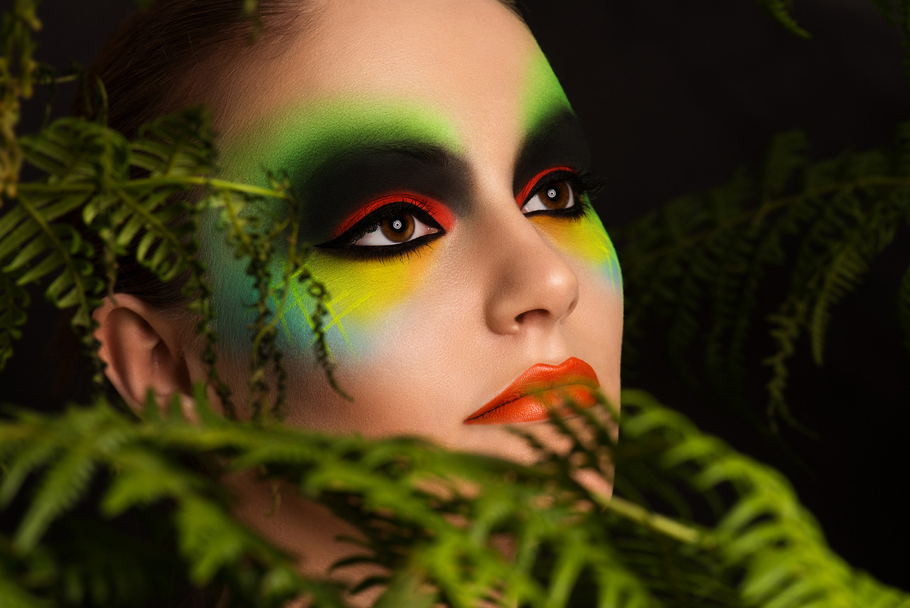 Tree Frog Inspired makeup creation. Martin Higgs often gives me challenges when it comes to makeup - this being one of them! So after receiving some tree frog images from Martin, I came up with this look! I used some coloured pencils as the base of these bright colours. Then I layered brightly coloured eyeshadows and then finished off using my Dinair Airbrush over the top to create this look. *Model - Hannah Nicholls *Photography - Martin Higgs *Makeup - Me *Retoucher - Stefka Pavlova