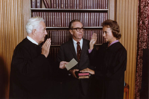 "ourpresidents:  On September 25, 1981, Sandra Day O'Connor became the first woman to be sworn in as a Justice of the U.S. Supreme Court.  President Reagan had nominated O'Connor earlier that summer, and he wrote in his White House diary, ""Called Judge O'Connor in  Ariz. and told her she was my nominee for Supreme Ct. Already the flack is starting and from my own supporters… I think she'll make a good Justice."" O'Connor helped inspire a generation of women to pursue careers in law—when she was appointed,  thirty-six percent of law school students were women; by the time she retired from the court in 2006 that percentage had risen to forty-eight percent. Last year, O'Connor spoke to a group of high school students at the Reagan Presidential Library in Simi Valley and told them:  ""It was exciting to be the first, but I did not want to be the last.""  Photo: Sandra Day O'Connor being sworn in as Supreme Court Justice by Chief Justice Warren Burger.  Her husband, John O'Connor looks on.  9/25/81. More from the Center for Legislative Archives"