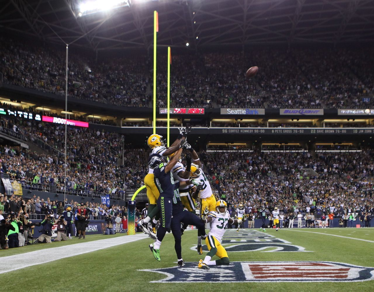 Russell Wilson's last-second Hail Mary heads toward the endzone during the fourth quarter of Monday's Packers-Seahawks game. Golden Tate would come down with the  catch to give Seattle a controversial 14-12 victory. (Otto Greule Jr/Getty Images) BURKE: Tate's catch highlights another ref debacleVIDEO: Watch the controversial final play | Highlights
