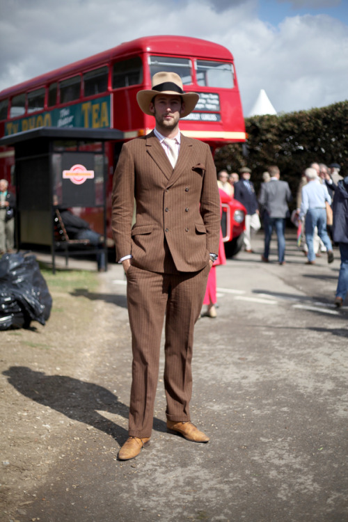 Classic 40s pinstriped tailoring from the Goodwood Revival vintage motoring event, complete with wide-brimmed fedora. Jonathan Daniel Pryce for WGSN street shot, Goodwood Revival 2012