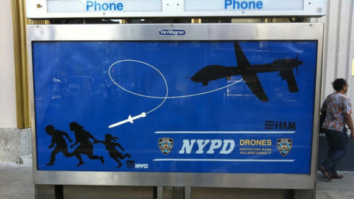 "poetrybyair:  Meet the Street Artist Who's Wanted by the NYPD for Punking the Police with Fake Drone Ads  His name is 'Essam' and he's a 29-year-old art school grad from Maine, who served in Iraq as a ""geo-spatial analyst"", and has put up posters like the one above all over New York. It shows drones being used to police regular people in an Orwellian world… with the NYPD logo plastered all over it, as if to endorse it. The NYPD wants him arrested, he wants to let people know the scariness of drones.  [Full article on gizmodo.com here]"
