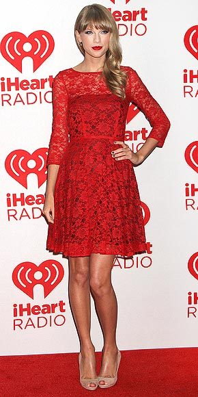 Red Carpet Style: Taylor Swift in French Connection Taylor wore a red lace French Connection dress ($198), along with Swarovski earrings and Prada peep-toe pumps, to the iHeart Radio Music Festival in Vegas. I have a very similar dress to this and love it. For a look for less, try this dress and these pumps.
