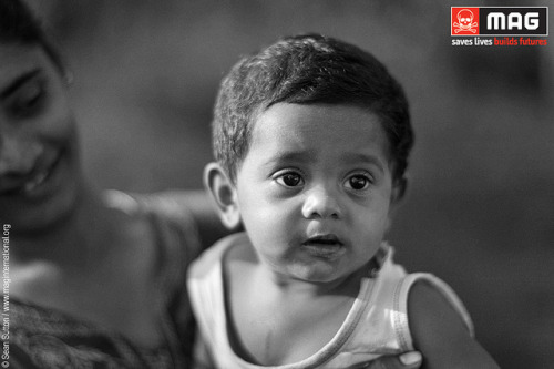 Pic of the Day: Born on a former minefield, Sri Lanka, 2012. on Flickr. Abishan was born on land cleared by MAG in the village of Devapuram in Mannar district, north-west Sri Lanka. Devapuram's residents were forced to flee during the country's conflict, as a result of escalating clashes between the Liberation Tigers of Tamil Eelam (LTTE) and the Sri Lanka Army.  When they returned, they found their homes destroyed and their farmland contaminated with landmines and unexploded ordnance. For more on MAG's operations in Sri Lanka, please look at www.maginternational.org/srilanka.