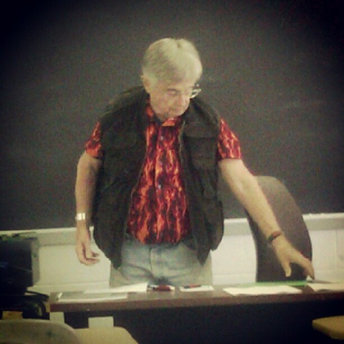 His outfit is adorable tho. #badfashion #outfit #science #flame #vest #whateven #professor #bored #lordhavemercy (Taken with Instagram)