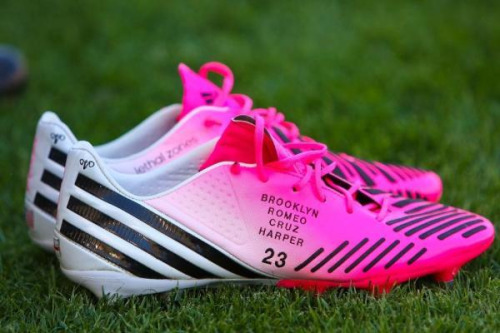 Here are a close up shot of David Beckham's football boots. The Adidas Predator LZ with the names Brooklyn, Romeo, Cruz, Harper on the side. V (Victoria Beckham) and the England flag on the heel.