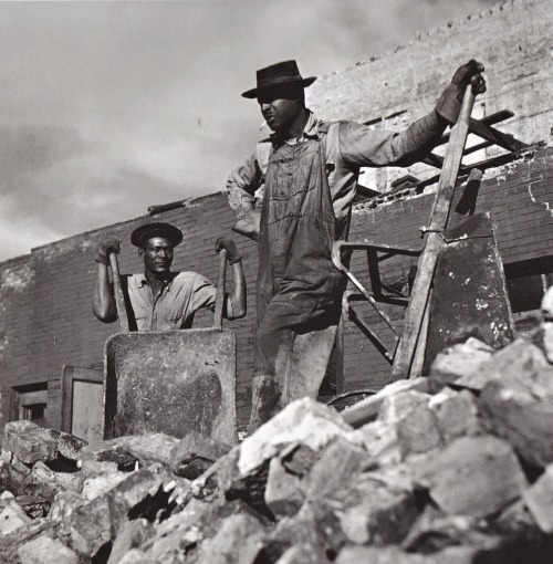 Workers demolishing building on Chicago's South Side, ca. 1940s.  (Photographer: Wayne F. Miller)