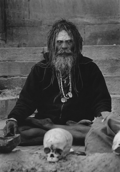 distortus:  The Aghori are a Hindu sect believed to have split off from the Kapalika order (which dates from 1000 A.D.) in the fourteenth century. Both Kapalika and Aghori sects are worshipers of Lord Shiva. Aghori means non-terrifying in Sanskrit, and may refer to how members of the sect view death. This extremely secretive community is known to live in graveyards, wear ash from the pyre, and use human bone from graveyards for rituals.Members of the Aghori drink from human skulls and practice cannibalism in the belief that eating human flesh confers spiritual and physical benefits, such as prevention of aging. The Aghori are widely censured in India for their use of human remains. It is believed that Aghoris perform Tantric ritual involving sex with lower caste, menstruating woman during which the Aghori becomes shiva and his partner shakti. Necrophagy, the eating of corpse flesh, is attested to by a sixteenth century Persian source and in nineteenth century British accounts.