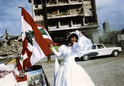 slouchingtowardsbeirut:  [via abustaif: A Lebanese bride poses next to the flag of Lebanon on a street in Beirut. Life appears to go on amid the destruction five years after the end of the civil war that ravaged the country and left it a political, economic, and physical shambles.]