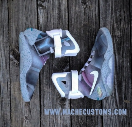 CUSTOM NIKE MAG BY MACHE CUSTOMS One of the ways that customizer headrunner Dan Gamache makes headlines is by altering base shoes that are deemed untouchable by many. It's a clever and bold approach. His recent attempt at the most coveted shoe of last year - and a silhouette that is still one of the hardest to find in all of streetwear - is the Nike MAG 2011 for the Michael J. Fox fundraising auction put on by Nike and eBay. Well, Mache did what Mache does, and altered the shoe into a custom that will sit proudly in his portfolio forever more. It's not a heavy alteration, but that's not the point with a base this rare. The artist has brought custom sneakers to the forefront, and recently spoke with Nicekicks on the topic in a great interview detailing a huge shift in the public reception of the art.