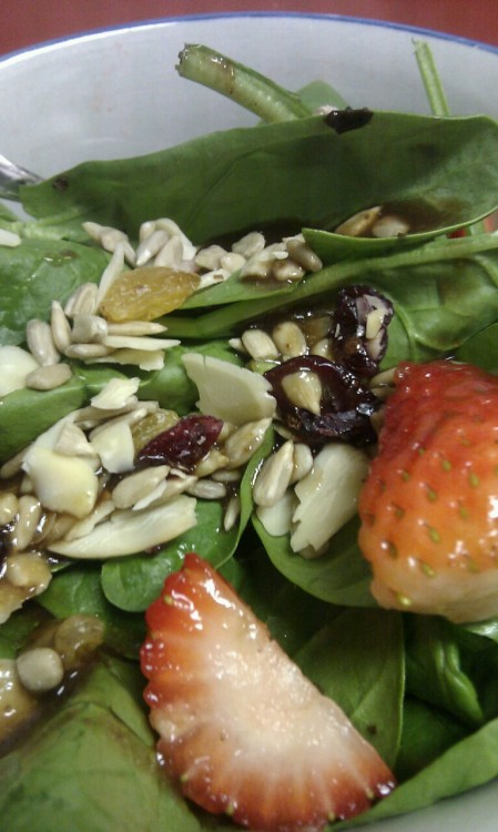 Spinach and Strawberry salad topped with walnuts, sunflower seeds and dried fruit for lunch.