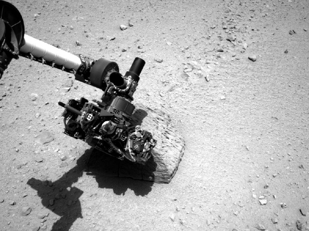 "ikenbot:  Curiosity Rover Touches 1st Martian Rock, Makes Longest Drive Yet NASA's Mars rover Curiosity reached out and touched a Martian rock with its huge robotic arm for the first time, then took off on its longest Red Planet drive to date. Curiosity spent the past several days investigating a strange pyramid-shaped stone named ""Jake Matijevic,"" testing out some of the gear at the end of its 7-foot-long (2.1 meters) arm. These tools include the Alpha Particle X-Ray Spectrometer (APXS), which measures elemental composition, and the Mars Hand Lens Imager close-up camera, or MAHLI. The rover performed these initial ""contact science"" operations on Saturday and Sunday (Sept. 22 and 23), researchers said. Photos snapped on those days show Curiosity's arm sidled up against ""Jake Matijevic,"" with the arm's turret obscuring most of the 16-inch-tall (40 centimeters) rock. Full Article"