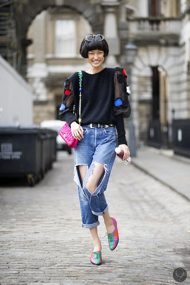Street Style: Captured in the streets of Paris, Wang Xiao balances an over-the-top sweater with a pair of well-loved Levi's.  Via I'm Koo.