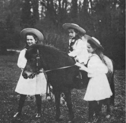 Olga, Anastasia and Tatiana Romanov play with their pony