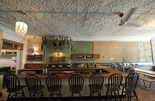 "Here's a look around The Pines, the highly anticipated Gowanus restaurant from Aaron Lefkove and Andy Curtin of Littleneck, and chef Angelo Romano, formerly of Roberta's and dearly departed Williamsburg restaurant Masten Lake. The menu here includes antipasti, a handful of seasonal salads and vegetable dishes, two pastas, and three meaty entrees. The dining room has a worn-in feel, and the space features a huge backyard with a trellis covered in grape vines.  Eater gets a first look of The Pines. In an email to friends, Lefkove adds: ""the menu is rather ambitious take on meats, pastas, veggies…..it is very market-driven and constantly changing based on what is available that morning so there is always going to be something new that wasn't there the last time. Lots of hand-rolled pastas (rolled fresh every day!) and house made tofu….and plenty of MEAT!!!!"" So there you go. It opened this week. Try the meat."