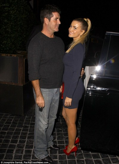the unlikely couple…X-Factor boss Simon Cowell and Carmen Electra out together last night in West Hollywood…