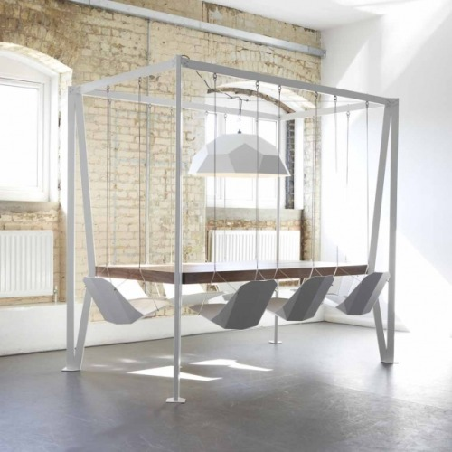 laughingsquid:  Swing Table, A Table With 8 Suspended Chairs  Why play with your food at the dinner table, when you can act like you've never left the playground? I imagine towels/napkins are necessary in this scenario. Lots of them.