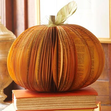 Unique Paper Pumpkin Centerpiece  Rescue an old book and turn it into a stunning piece of autumn decor in a few easy steps. Remove the front and back cover of the book and trace our pattern, available below, onto the first page. Place a cutting mat under about five pages and cut along the traced line using a crafts knife. Us  e the cut pages as a template to cut the rest of the pages.Break the spine of the book by opening it in the center. Fold the spine back onto itself and hot-glue together; lay the book flat until the glue sets. Hot-glue the first and last pages of the book together near the spine. Secure each page with a bead of hot glue along the spine to begin forming a rounded fan shape. When you are halfway through the pages, switch to the other side of the book and repeat. Paint your pumpkin using orange and brown spray paint; add an artificial leaf and stem to finish the project.