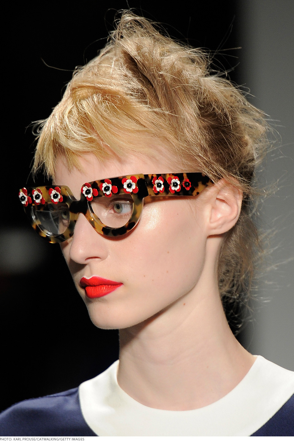 These glasses are cute! Loved that they used red lipstick as well to match the flowers! (via The Makeup We Loved From Milan Fashion Week)