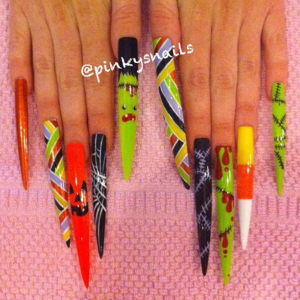 "GIVEAWAY FOR HALLOWEEN TALONS!  Imagine how fierce your costume will be this Oct 31 with this custom Pinky's Nails extreme set (over a $75 dollar value!!)! Just post your favourite Pinky's pic with ""FOLLOW @PINKYSNAILS #spookypinkys"" in the comment!  Winner is chosen at random so GOOD LUCK!   (Taken with Instagram at Pinky's Nails)"