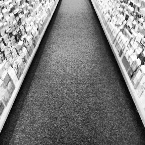 #symmetry #isle #photography #store #cards #lines #road #leading #shapes #photography #android (Taken with Instagram)