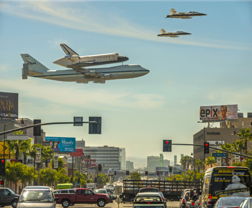 Space shuttle Endeavor aboard a 747 on its last flight to LAX. Now retired, the space shuttles are all museum pieces, scheduled to be towed along the streets of LA to the California Science Center. | Credit: Stephen Confer