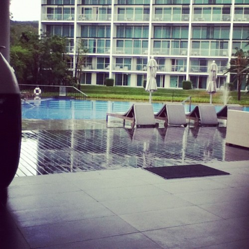 Poolside. What a wet day (Taken with Instagram at Outrigger Lobby)