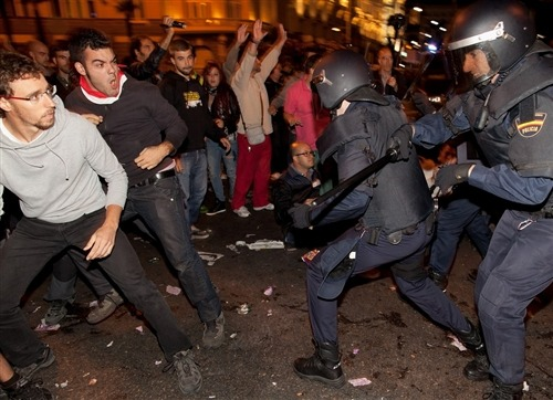 nbcnews:  Rage against austerity: Violent clashes erupt in Spain, Greece goes on strike (Photo: Pablo Blazquez Dominguez / Getty Images) Dozens of anti-austerity protesters were arrested after violent clashes in Spain on Tuesday and riot police were on standby in Greece as workers walked off their jobs on Wednesday over the European Union's policy of imposing austerity on countries mired in debt. Spanish police told The Associated Press that 38 people were arrested and 64 people injured when officers clashed with protesters demonstrating against cutbacks and tax hikes. Read the complete story.
