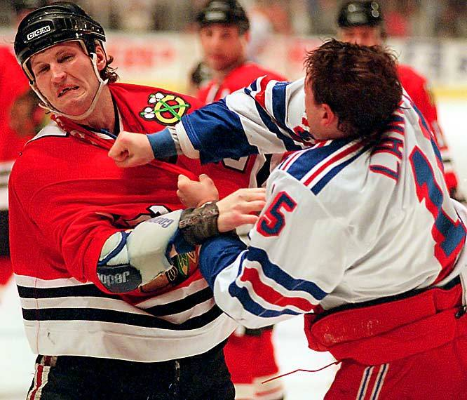 Bob Probert takes a right to the jaw from Darren Langdon during a 1997 Rangers-Blackhawks game. (AP) GALLERY: Hockey's Faces of Battle