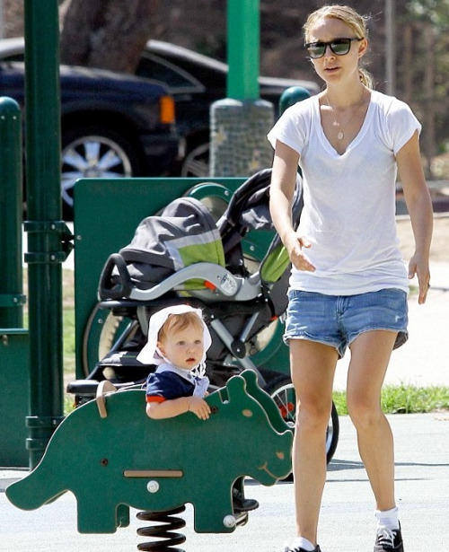 Natalie Portman's baby looks surprised to find himself at a public park. I understand you, Aleph. I never go to places where other children touch things without latex gloves and a tetanus booster.