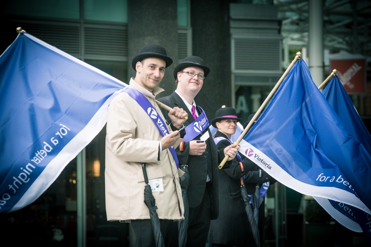 Purple Flag Week - What's It All About Awarded by the Association for Town Centre Management (ATCM), the Victoria Business Improvement District (BID) achieved Purple Flag status in October 2011 and became the first BID to achieve this accolade. Our business partnership was awarded this accreditation in recognition of our achievement in surpassing the standards of excellence set for a prosperous, safe and secure night-time economy in Victoria.Purple Flag Week (PFW), scheduled for 24th – 30th September, is the annual UK-wide campaign to promote town and city centres at night through ATCM's accredited Purple Flag scheme. As an accredited centre, during this week, the Victoria BID intends to capture the creativity and imagination of residents, visitors and businesses alike to promote the evening economy and encourage people to stay and try doing something different in Victoria after dark.Purple Flag Week provides all of us with a unique opportunity to come together around a campaign that is clear and attractive to those who visit, work or live in Victoria as well as the media, with the aim of raising our profile within the programme on a national level.