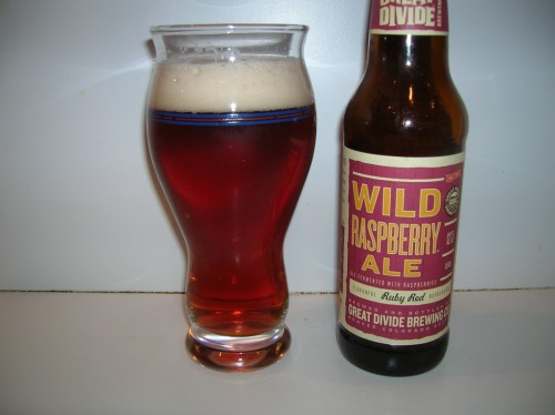 #414: Wild Raspberry Ale – Great Divide Brewing Company, Denver, Colorado Fruit beer and I have a tumultuous history. We don't get along that often, and I'm not talking about Belgian Lambics here. I'm talking about those vapid, thin-bodied, candied flavor fruit beers that manage to clog shelves with their teeth-rotting sweetness overload. But I hold out hope for one that might make me a believer. Great Divide's a quality brewer, so let's see what they've got here. This raspberry ale checks in at 5.6% ABV. Pours with a beautiful, burnished ruby red tone, deep, dark and lovely, with remarkable clarity. It's certainly been filtered quite well, and it's capped off by an off-white head of creamy foam. A delightful, complex aroma of subtle acidic raspberry whips around the nose gently, not at all wrapped in the fakery syrup notes that scare me off in most fruit beers. Excellent texture on the body of this one. It avoids the common fruit beer pitfall combination of weak body, sickly fruit flavor. Instead, the acidic, prickly raspberry flavor is folded within a substantial body of sweet (but not too sweet), bready malt flavor, with a delicate level of carbonation to keep things flowing smoothly. Green hoppy bite in the finish to go along with the sweet, subtle touch of raspberry on the throat. The Verdict: Fruit beer done very, very right. With exception to fruit lambics, it's perhaps the best fruit beer I've had. No sickly mess, no weak body, just a sturdy beer with outstanding fruit flavor and a substantial body to back it up. Great stuff.
