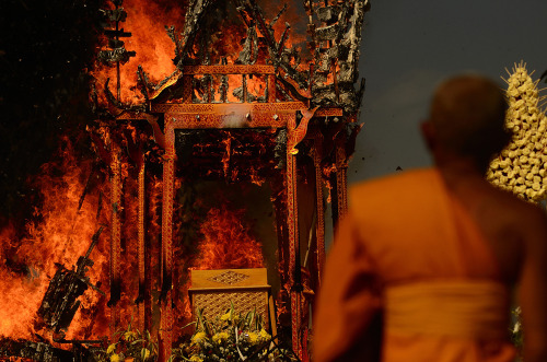 "globalyodel:  ""Cremation of a high ranking Buddhist abbot. The villagers built a special building for him, just to burn it down a few days later with his body inside. The ceremony went on for days."" Travel to Chiang Mai, Thailand through the lens of local filmmaker Ryan Libre."