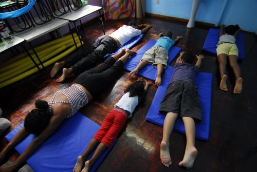 unicef:  Children practice yoga and relaxation techniques in the playroom at GAPA (AIDS Prevention and Support Group) in Salvador, capital of the eastern state of Bahia in Brazil. Many of the children are being treated with universal antiretroviral (ARV) therapy, provided free of charge by the Ministry of Health. The UNICEF-assisted NGO advocates for the rights of HIV-positive children, including the right to life, health, nutrition, education, social and community life. © UNICEF/NYHQ2006-1324/Claudio Versiani http://www.unicef.org